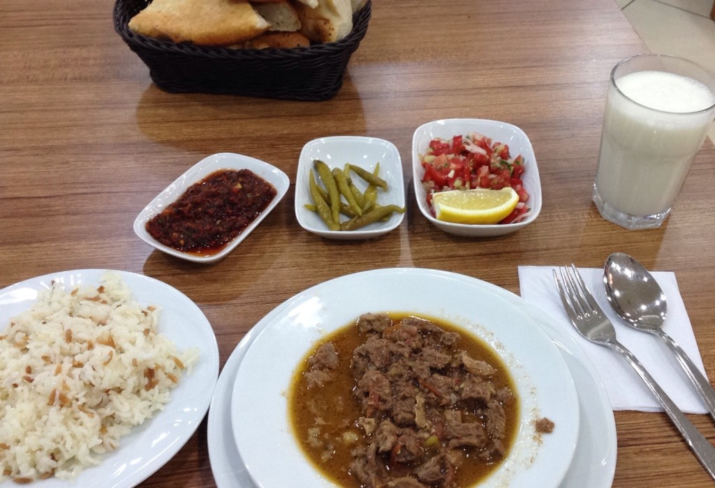a classical turkish dinner (lunch) The soup, chillies, tomato and cucumber salad as well a hot dip is usual. Homemade bread, rice and a lamb stew. The classical drink is Ayran, a mixture of Joghurt, Water and Salt, ice-cold served.