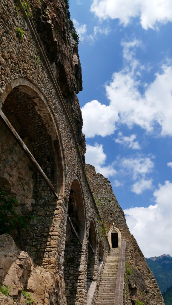 The large aqueduct at the entrance, which supplied water to the Monastery, is constructed against the side of the cliff. The aqueduct has many arches which have mostly been restored.