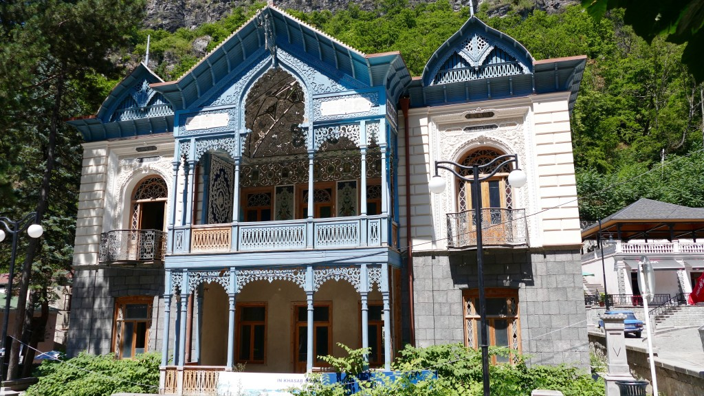 """Blue Palace """"Firuza"""" """"Firuza"""" is one of the most important historical buildings in Borjomi. Situated at the entrance of the """"Mineral Water Park,"""" it was built in 1892 by the consul of Iran and is considered a unique cultural monument. The building combines characteristics of Persian, Georgian and European styles."""