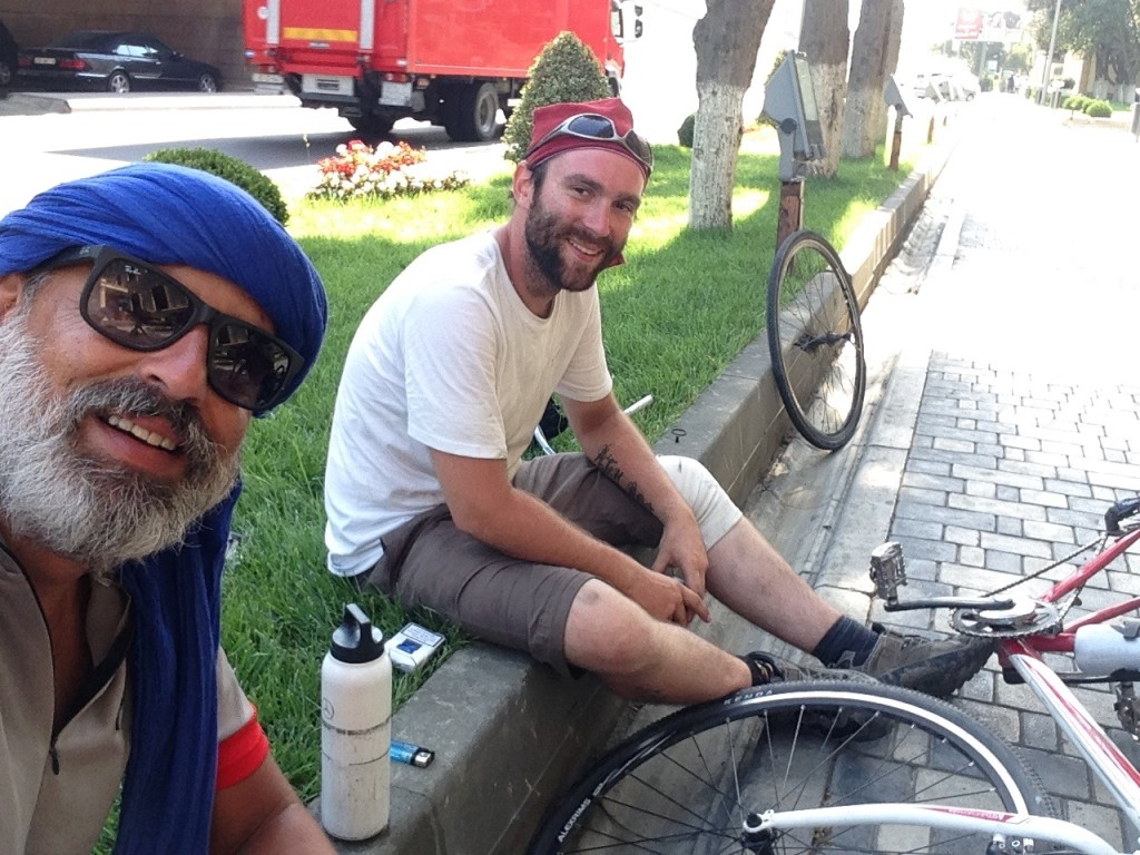 Gwyd repairing their flat tire.