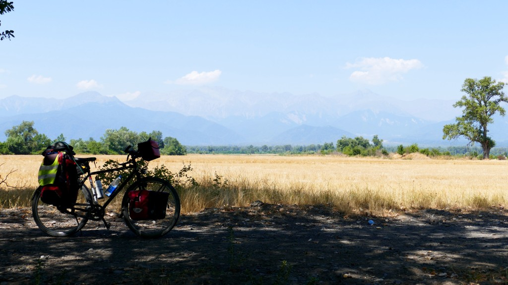 Steppe, on the Background the greater Caucasus. On this place I meet with Gwydion from Wales, riding his bike to Baku