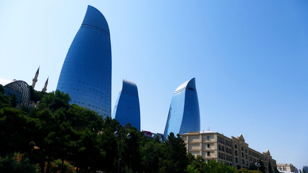 Flame Towers (Azerbaijani: Alov Qüllələri) is the tallest skyscraper in Baku, Azerbaijan with a height of 190 m (620 ft). The buildings consist of apartments, a hotel and office blocks. The estimated cost of Flame Towers is around US$350 million. Construction began in 2007, with completion in 2012. HOK was the architect for the project, DIA Holdings served as the design-build contractor, and Hill International provided project management. The facades of the three Flame Towers are turned into gigantic display screens with the use of more than 10,000 high-power LED luminaires, supplied by the Osram subsidiary Traxon Technologies and Vetas Electric Lighting. On 5 June 2014, Lamborghini opened a branch in Azerbaijan for the first time. Its dealership is located on the ground floor of the East tower of the Flame Towers.