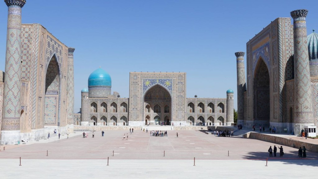 "During centuries Registan Square was the center of Samarkand. The word Registan means ""sand place"". There was a river running there many ages ago, before building the first Madrassah on the square. Years passed, the river dried out and left lots of sank there, that was the first place where the first Madrassah was built in the beginning of the 15th century and named Registan square. As the Madrassah was first built, all the holidays, parades, festivals and Sunday bazaars took place."
