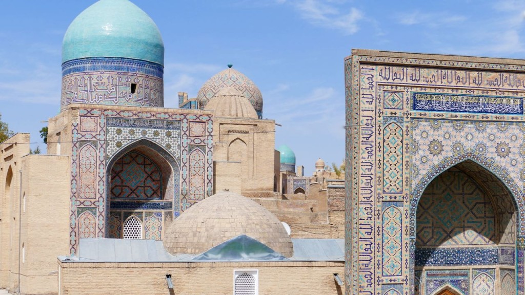 Shakhi Zinda complex. It consists of rows of refine sparkling blue colors tombs. Harmoniously combined in a lively and moving composition, various mausoleums are grouped along the narrow medieval streets. Shakhi Zinda consists of eleven mausoleums, which were built one after another in XIV - XV centuries.